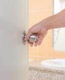 Man hand holding door knob. Man hand open the door Stock Photo