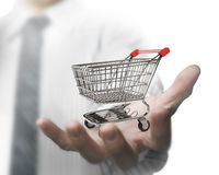 Man hand holding empty shopping cart Stock Images