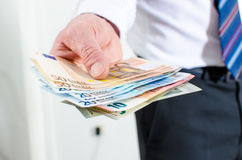 Man hand holding euro notes Royalty Free Stock Photography