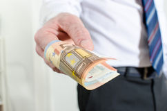 Man hand holding euro notes Stock Photo