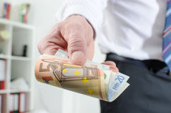 Man hand holding euro notes Royalty Free Stock Photo