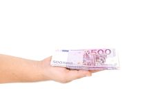 Man hand holding five hundred euro bills. Stock Photo