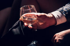 Man hand holding a glass of champagne Royalty Free Stock Images
