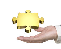 Man hand holding golden puzzle piece Royalty Free Stock Photo