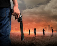 Man Hand Holding Gun Fighting Zombie Stock Photos