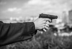 Man hand holding gun. Stock Image