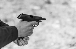 Man hand holding gun. Royalty Free Stock Photography