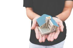 Man hand holding a  home model on isolate white background Stock Photo