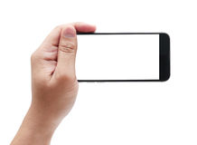 Man hand holding horizontal the black smartphone with blank scre Royalty Free Stock Image