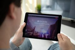 Man hand holding iPad Apple Arcade video game subscription service. Anapa, Russia - March 29, 2019: Man hand holding iPad Pro with Apple Arcade video game royalty free stock image