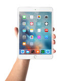 Man hand holding the iPad mini 3 retina. Man hand holding the iPad mini 3  retina with displayed home screen isolated on white background Stock Photo