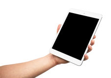 Man hand holding the iPad mini 3 retina. Isolated on white background Royalty Free Stock Photos