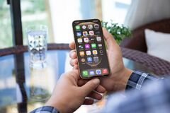 Free Man Hand Holding IPhone 12 Pro Max Gold IOS 14 Stock Photography - 219742802