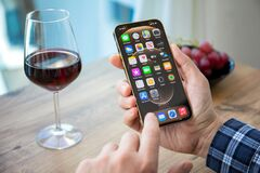 Free Man Hand Holding IPhone 12 Pro Max With IOS 14 Stock Images - 207663354