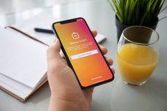 Man hand holding iPhone X social networking service IGTV Instagram. Alushta, Russia - July 27, 2018: Man hand holding iPhone X with social networking service stock photos