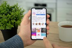 Man hand holding iPhone X with social networking service Instagram. Alushta, Russia - December 26, 2017: Man hand holding iPhone X with social networking service stock images