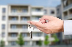 Man hand holding keys to new house Stock Photography