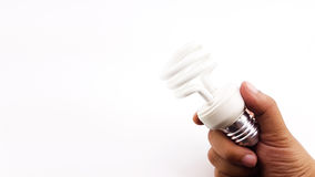 Man hand holding the LED Spiral Light Bulbs.  Stock Photography