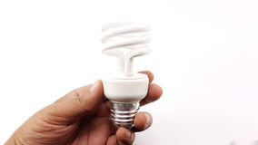 Man hand holding the LED Spiral Light Bulbs. Isolated Royalty Free Stock Images