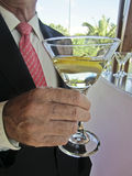Man hand holding martini cocktail Royalty Free Stock Photography