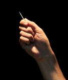 Man hand holding matchstick Royalty Free Stock Image