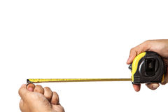 Man hand holding a metallic tape measure isolated on a white bac Stock Photos