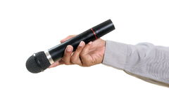 Man hand holding microphone Stock Images