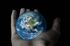 Man hand holding model of earth Royalty Free Stock Photography