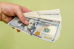 Man hand holding money dollars  Stock Photography