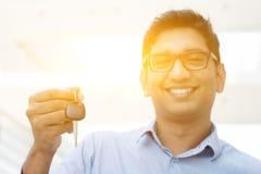 Man hand holding new car key Royalty Free Stock Image