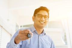 Man hand holding new key stock image