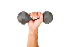 Man hand holding old dumbbell on white background Stock Image