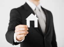 Man hand holding paper house Royalty Free Stock Photography