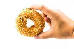 Man hand holding peanut donut isolate Stock Images