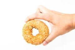 Man hand holding peanut donut isolate Stock Image