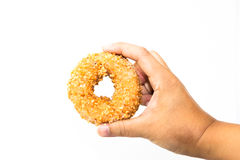 Man hand holding peanut donut isolate Royalty Free Stock Photography