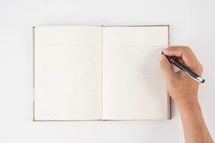 Man hand holding pen and writing notebook  on white background f Stock Image