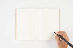 Man hand holding pen and writing notebook  on white background f Stock Photo