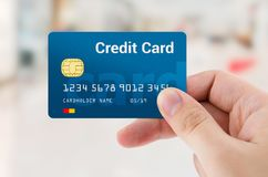 Man hand holding personal credit or debit card Royalty Free Stock Photos