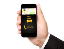 Man hand holding the phone with interface taxi Stock Images