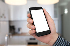 Man hand holding phone isolated screen background home room kitc Royalty Free Stock Photography