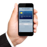 Man hand holding the phone with mobile wallet onlain shopping on Stock Images