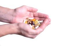 Man hand holding pills Royalty Free Stock Image