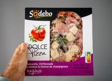 Man hand holding Pizza box gray background stock photo