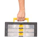 Man hand holding plastic tool box. Royalty Free Stock Photo