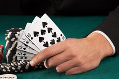 Man hand holding poker cards Stock Photo