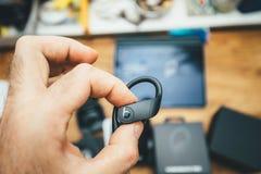 Man hand holding Powerbeats Pro headphone with logotype insignia. Paris, France - Jun 17, 2019: Man hand holding Powerbeats Pro Beats by Dr Dre wireless high stock image