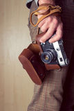 Man hand holding a retro camera Royalty Free Stock Images