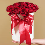 Man hand holding rich gift bouquet of 21 red roses. Composition Stock Images