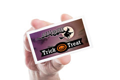 Man hand holding scary Halloween party card or invitation Stock Image